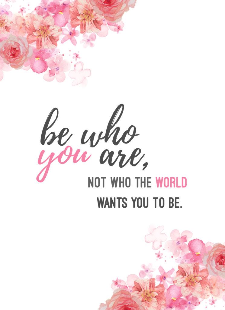 """Floral wall art with pink flowers and text that reads """"be who you are, not who the world wants you to be"""""""