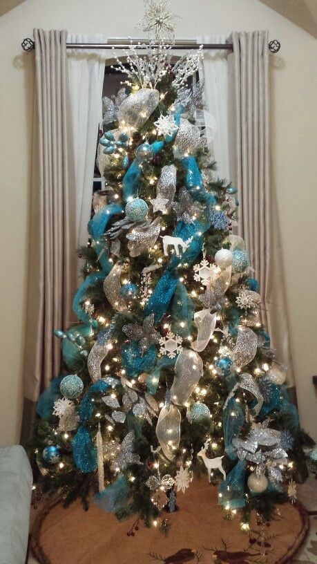 This Christmas tree uses ribbon to create a lovely color scheme. I love the bright blue ribbon with all the white pieces.