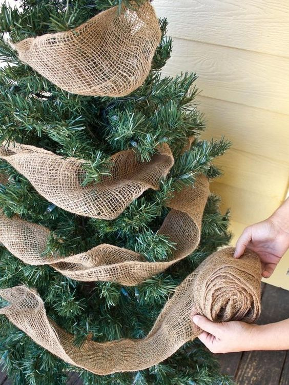 Burlap ribbon is a great way to add a rustic touch to your Christmas tree