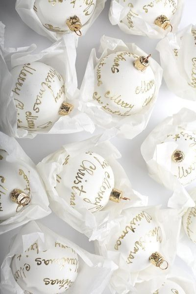 I love these white and gold Christmas ornaments with sparkling gold script.