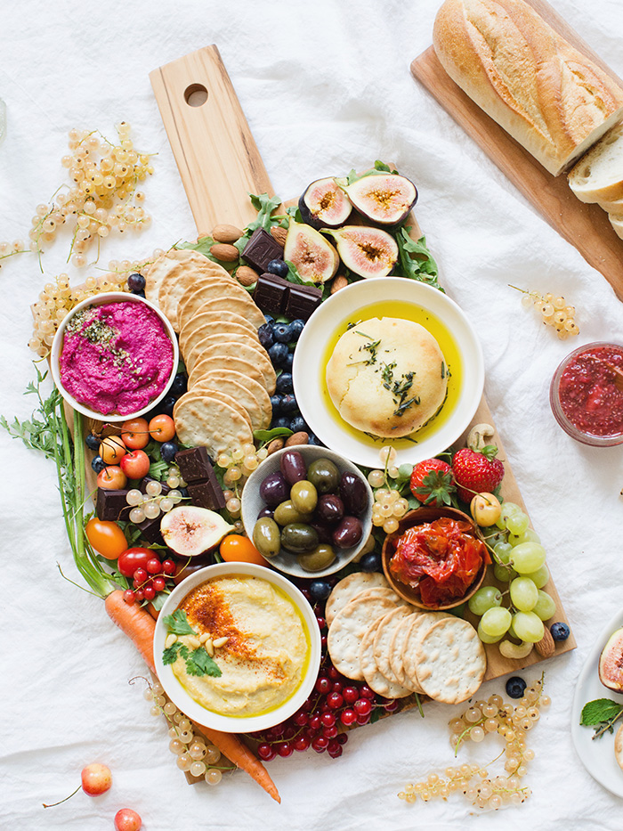 this fresh and colorful vegan charcuterie board is packed with fresh fruits and veggies, crackers, and more