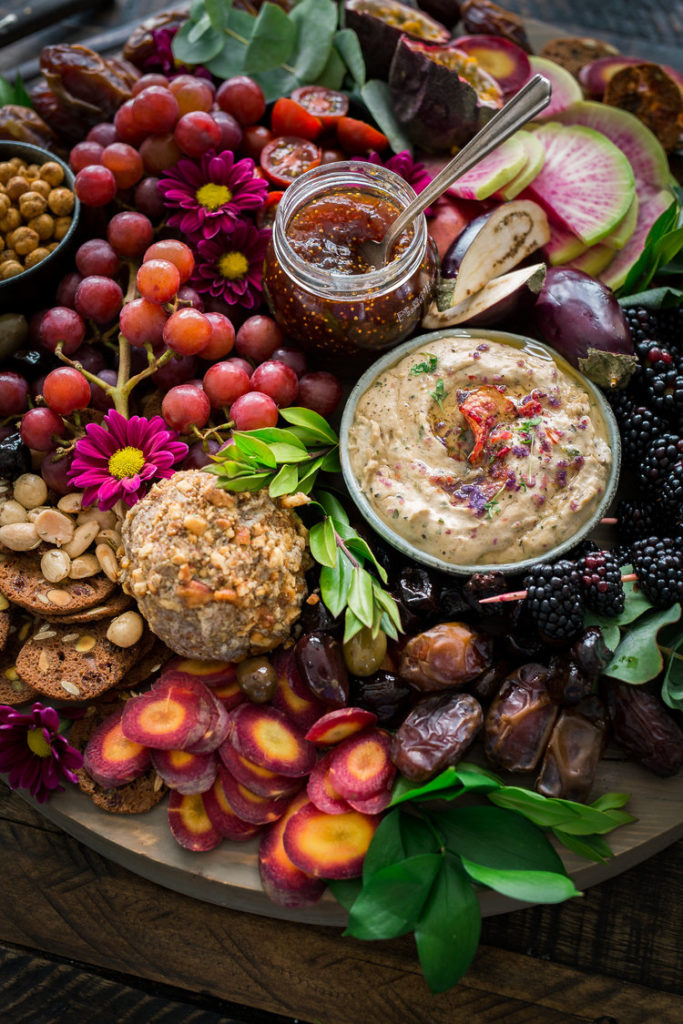 this vegan charcuterie board is packed with fresh purple color from veggies, fruits, and sweet dips and spreads