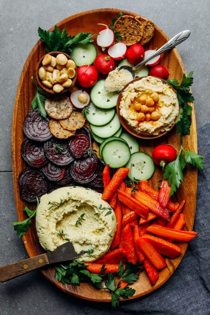 this vegan charcuterie board has vegan cheese, delicious veggies nuts for a complete spread