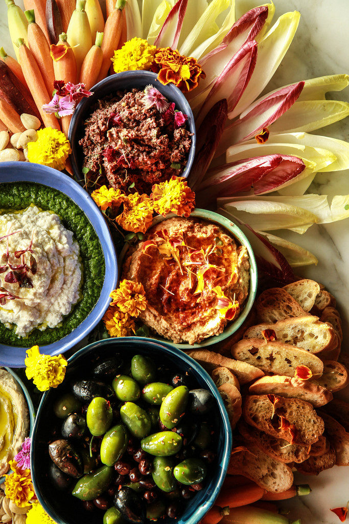 this vegan charcuterie board is packed with delicious vegan appetizers that will please the whole party