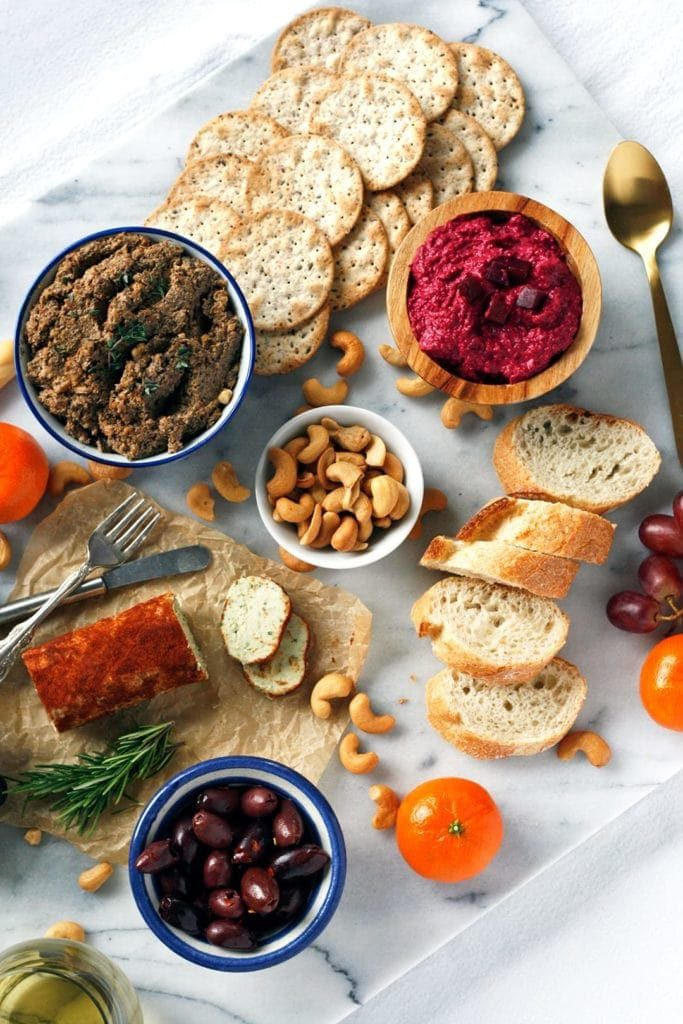 this vegan charcuterie board is perfect for Valentine's Day with light appetizers, crackers, dips, and bread