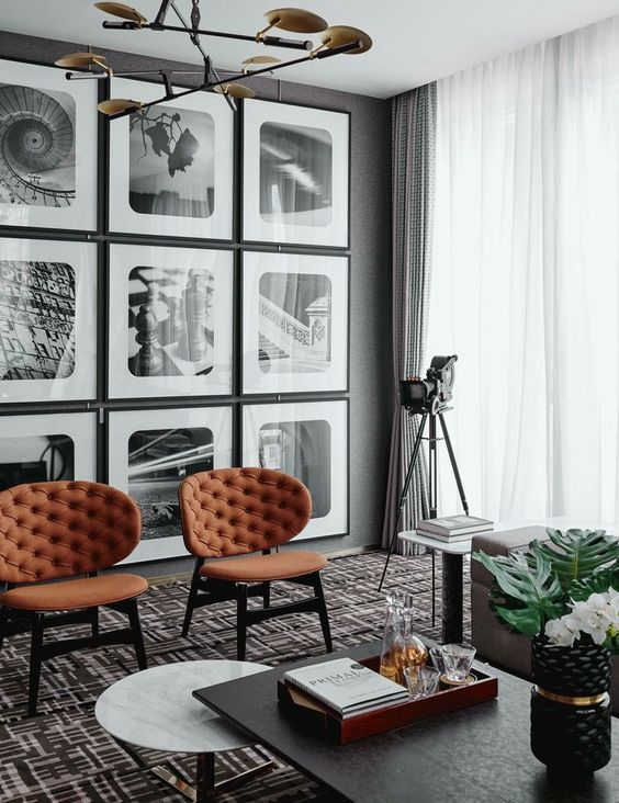 I love these large art prints on this gallery wall! The rounded corners of the frame mats really add a unique style that works with the decor in the room.