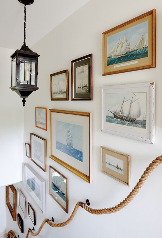 This stairway gallery wall is a collection of artwork that fits one theme. The different images, sizes, and frames really makes it an eclectic, lovely wall!