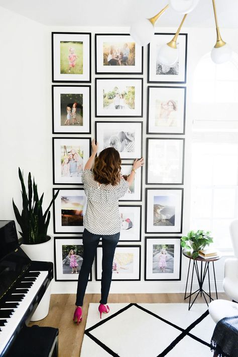 I love the design of this gallery wall! Two outer rows of vertical pictures and a center row of horizontal pictures really gives this gallery wall a great balance