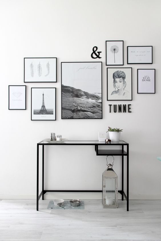 This gallery wall is a collection of lovely artwork, all in simple black frames. I love the different sizes and styles of all the pieces, making it a very personalized gallery wall!
