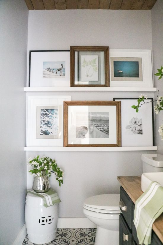 This bathroom gallery wall is a collection of beach images that are all in different frames and sizes! I love using shelves to display pictures in a gallery wall.