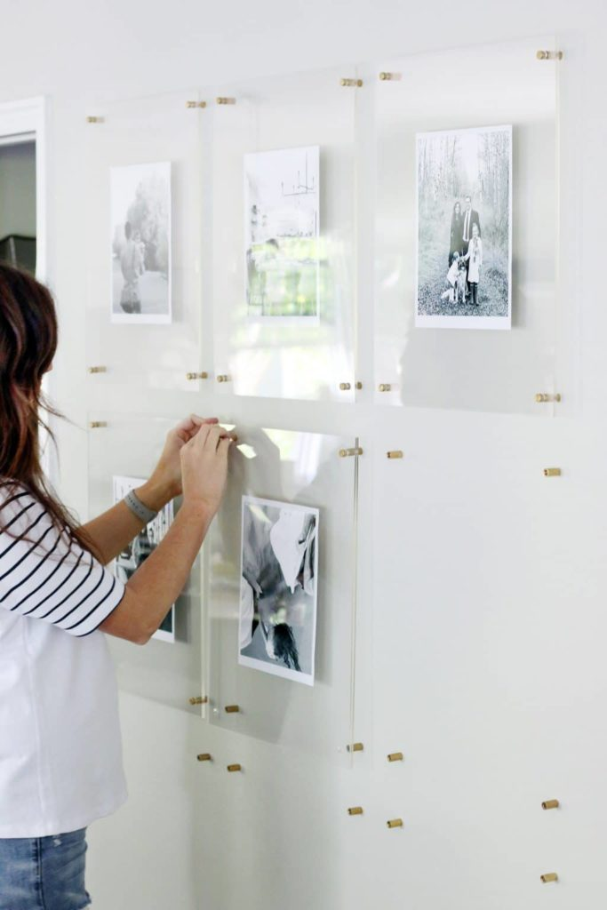 The all glass display frames on this gallery wall make this look more like an art gallery! This is a creative and unique way to display family memories