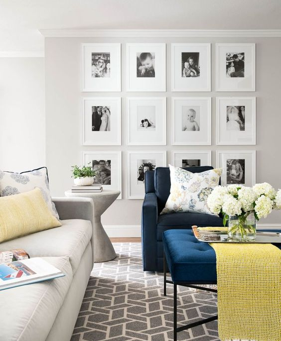This DIY gallery wall displays precious family memories in simple white frames. I love the wide photo mats, which really bring the focus in on the images.