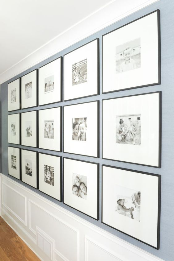 This DIY gallery wall displays precious family memories in simple black frames. The wide photo mats really bring the focus in on the pictures of the kids and family!