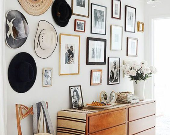 DIY photo gallery wall idea to help you design the best piece of art in your home! Black and white photos, large, gold frames, mixed frames, full wall - #goldframes #largegallerywall #blackandwhitephotos || Nikki's Plate