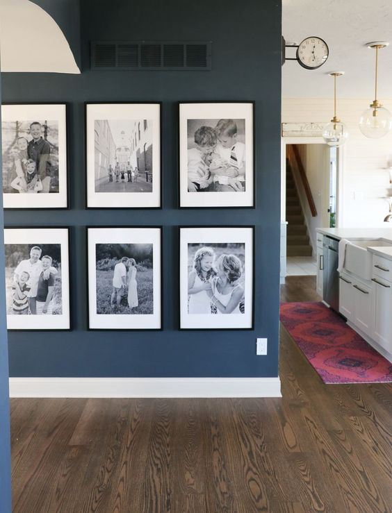 I love the black and white images in black picture frames on this gallery wall! These look like such precious family memories!