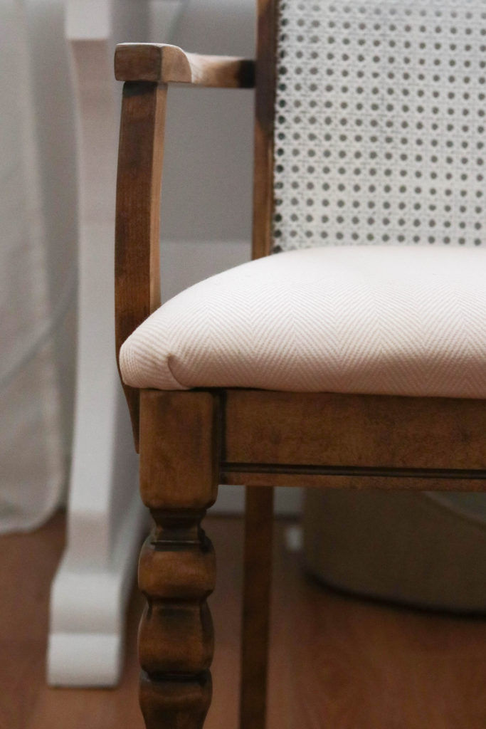 This antique office chair makeover was so easy! Here's a look at the chair after a fresh stain and new seat cover.