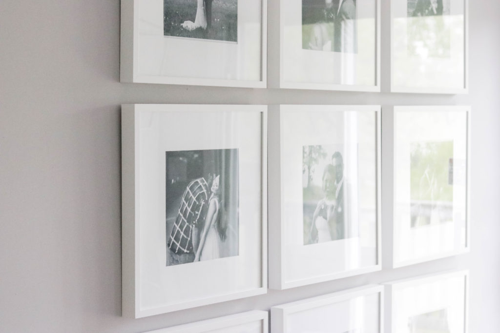 Here's how we put together a large photo gallery wall, plus super simple tips and tricks to make a gallery wall look perfect.