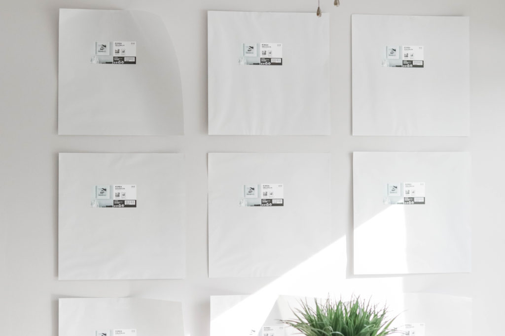 Using the paper inserts that come in your picture frames is a super simple way to plan out what you want your gallery wall to look like!