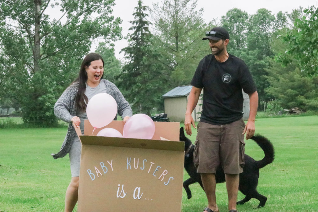 Gender Reveal Party - box revealing gender with balloons
