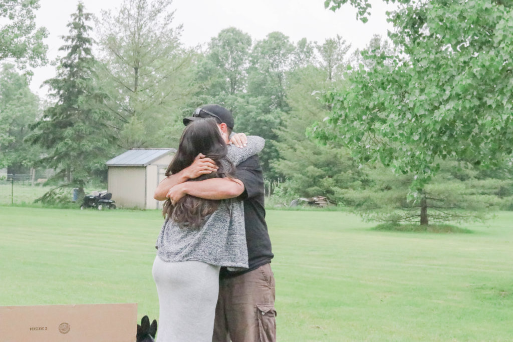 Gender Reveal Party - the mom and dad hugging after finding out their baby is going to be a girl