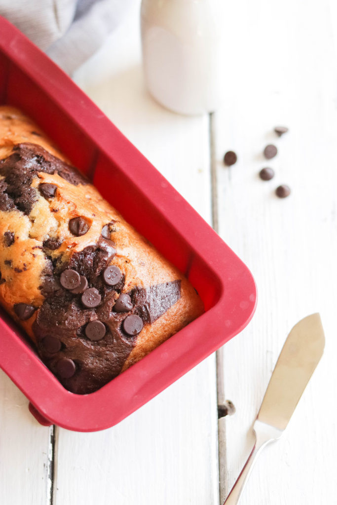 This delicious Vegan banana bread is swirled with rich chocolate and topped with chocolate chips