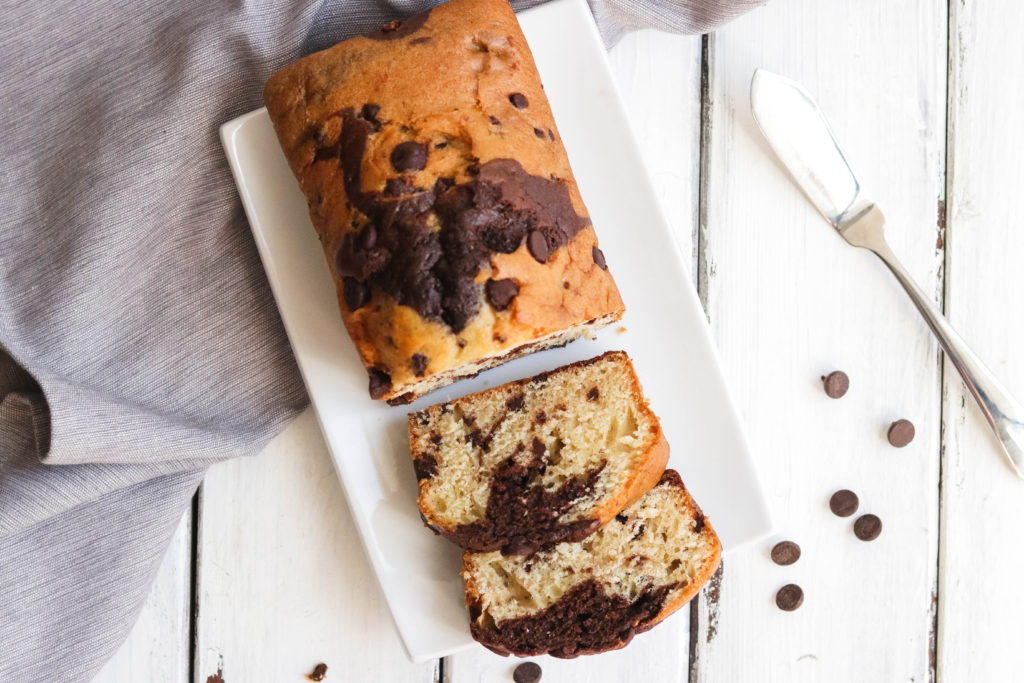 Vegan chocolate chip banana bread has a sweet swirl of chocolate throughout and has chocolate chips in every bite!