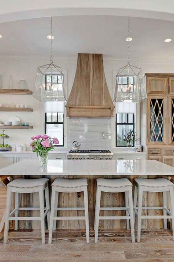 White Kitchen Designs You Haven't Seen Yet! Beautiful white kitchen inspiration for your remodel. Marble Countertop, wood bar stools, island light, island, bright white #whitekitchen #farmhouse