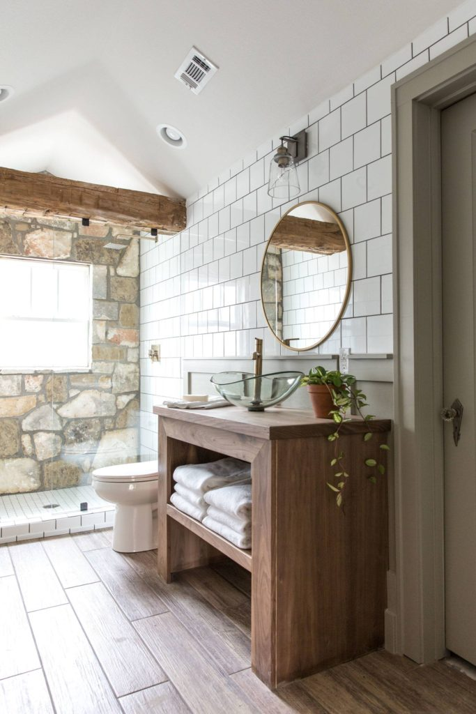 Best Bathrooms by Joanna Gaines; Fixer upper's top bathroom renovations by Joanna and chip Gaines! These rustic, country with hints of modern perfection bathrooms are everything #joannagaines #bathroom #bathrooms #renovations || Rustic Bathroom, Wood Vanity, Round Mirror - Nikki's Plate