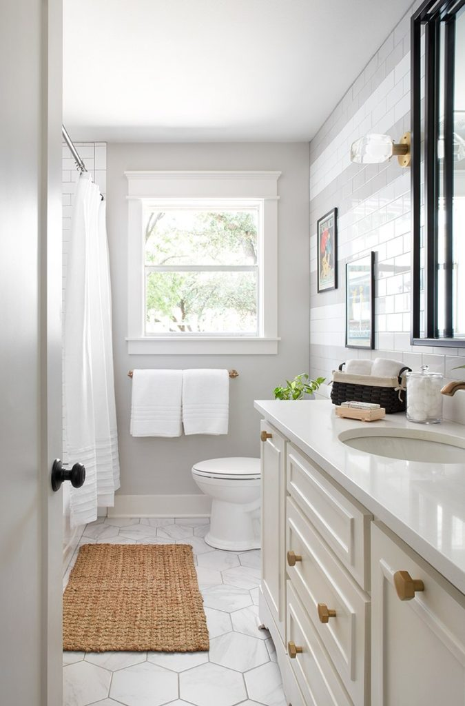 Best Bathrooms by Joanna Gaines; Fixer upper's top bathroom renovations by Joanna and chip Gaines! These rustic, country with hints of modern perfection bathrooms are everything #joannagaines #bathroom #bathrooms #renovations || White Vanity, Gray Walls, White Tile - Nikki's Plate