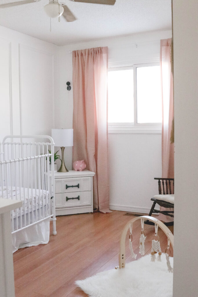 Baby Girl White and Pink Nursery Reveal; White vintage crib, name sign on wall, wainscotting