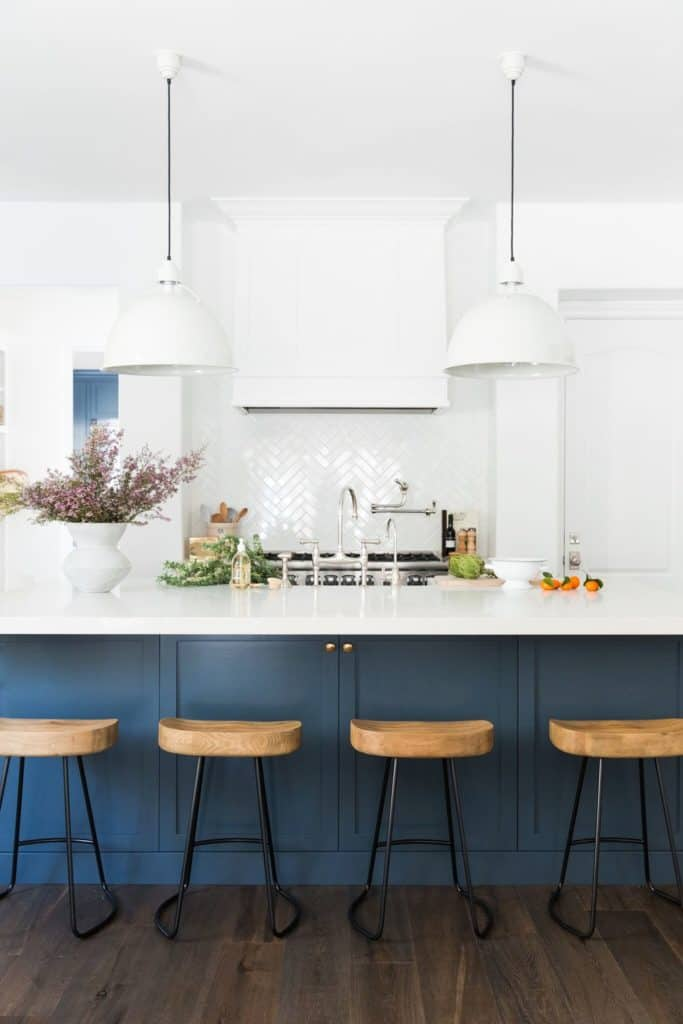 11 Best Kitchens by Studio McGee; The bold, dark navy cabinets in this kitchen were a great choice to pair with the stark white walls and counter tops