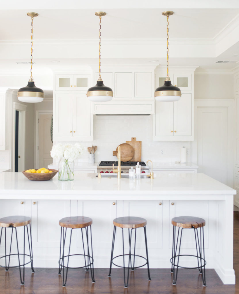 11 Best Kitchens by Studio McGee; This all-white farmhouse style kitchen has so much open, inviting space for family and guests