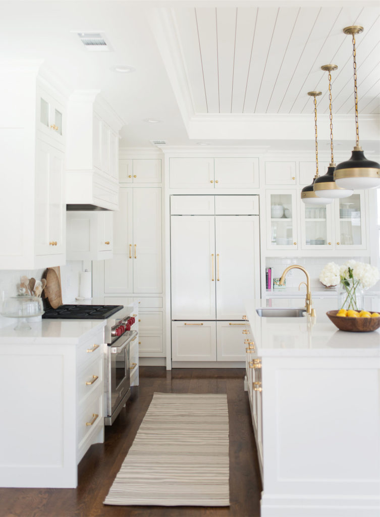 11 Best Kitchens by Studio McGee; This all-white kitchen look clean and morden. I love the gold hardware throughout the kitchen, on the sink, and the light fixtures