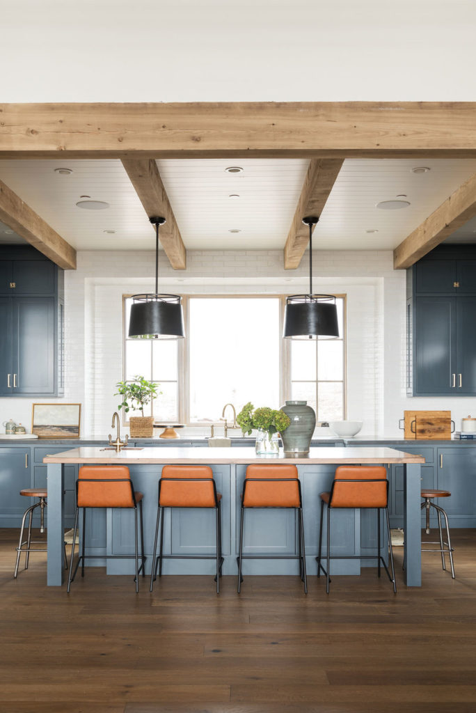 11 Best Kitchens by Studio McGee; I love the wide open, bright space of this kitchen, the cobalt blue cabinets, and the gorgeous rustic beams on the ceiling!