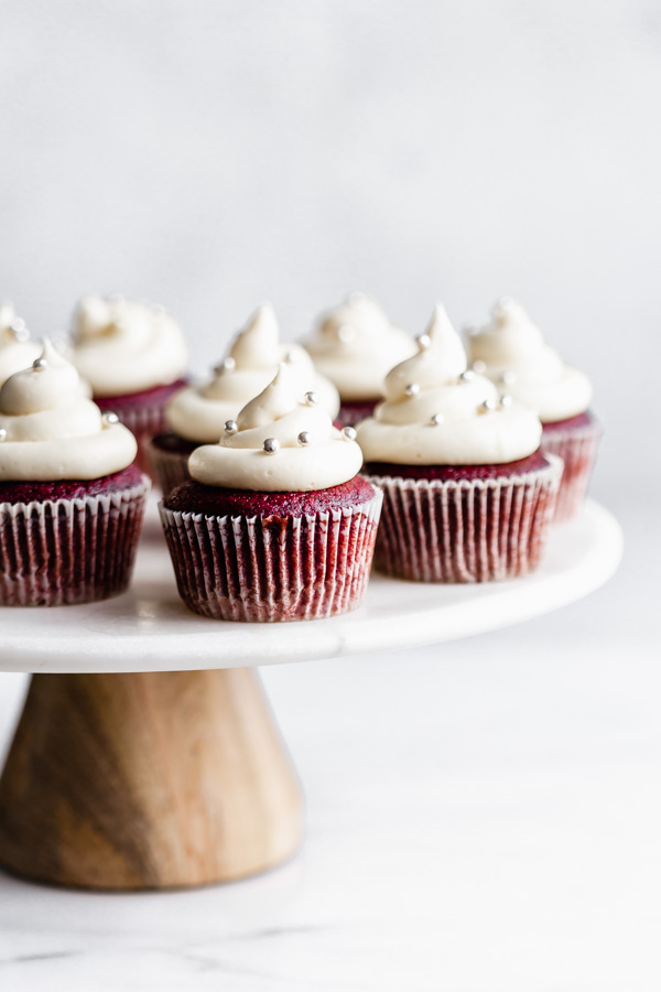 Vegan red velvet cupcakes are the ultimate healthy dessert! Sweet cream cheese frosting tops moist, chocolatey red velvet cupcakes.