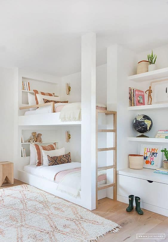 Here are 9 bedroom style tips for twins! Take a classic children's bedroom and off a stylish twin twist with these unique interior design ideas! #TwinBedrooms #TwinRooms #bunkbeds || Nikki's Plate