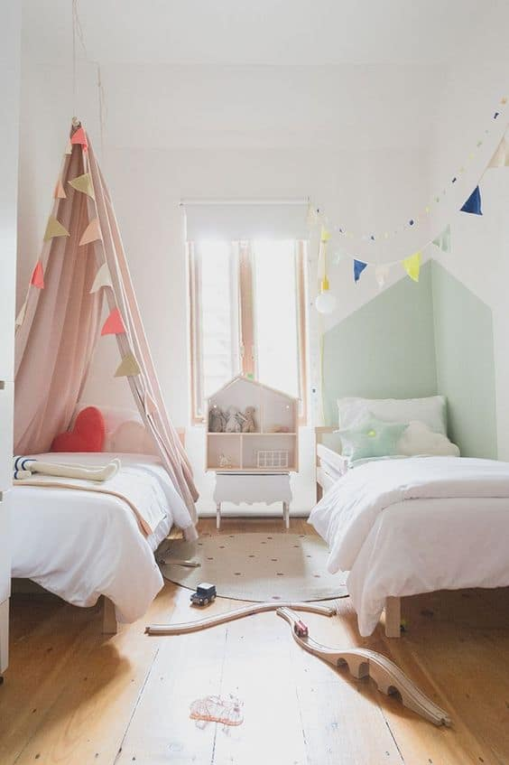 Here are 9 bedroom style tips for twins! Take a classic children's bedroom and off a stylish twin twist with these unique interior design ideas! #TwinBedrooms #TwinRooms || Nikki's Plate