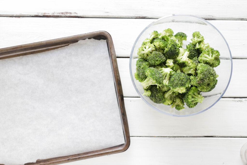 Ready to pour on pan Crispy Broccoli with Vegan Cheese Sauce; dairy and gluten free side dish for your vegan dinner! A nut free cheese sauce that you will love smothered on your blackened broccoli!