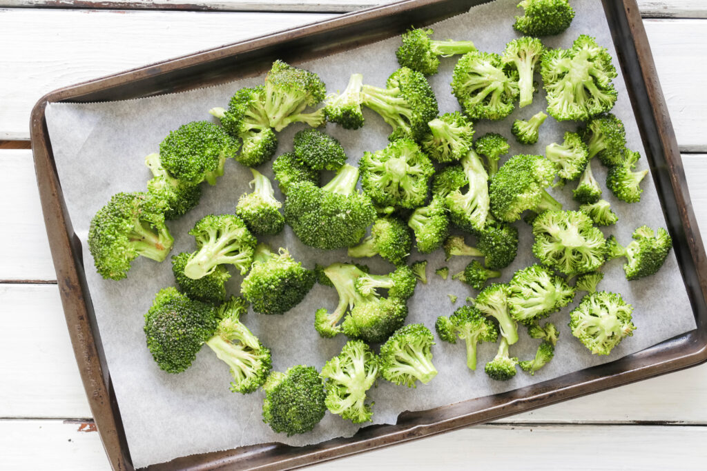 Pan of Crispy Broccoli with Vegan Cheese Sauce; dairy and gluten free side dish for your vegan dinner! A nut free cheese sauce that you will love smothered on your blackened broccoli!