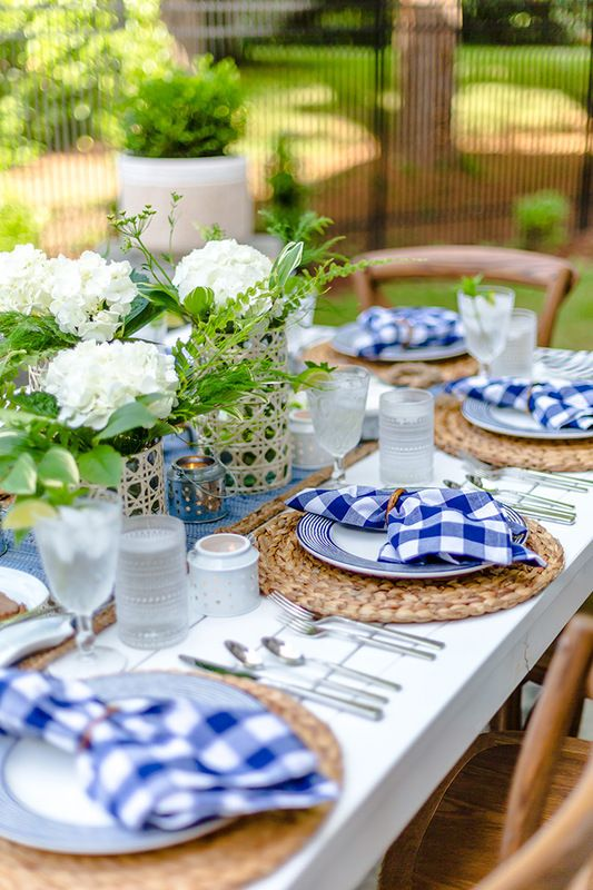 15 Deck Must Haves for Summer Entertaining; outdoor plates table setting, blue patio place settings