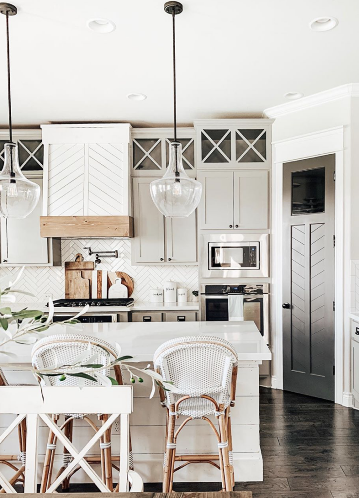 Best Home Decor Instagram Accounts You Should Be Following; White kitchen, clear pendents, farmhouse