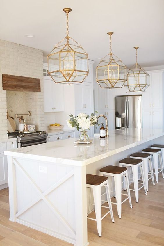 Best Home Decor Instagram Accounts You Should Be Following; White kitchen, gold pendents