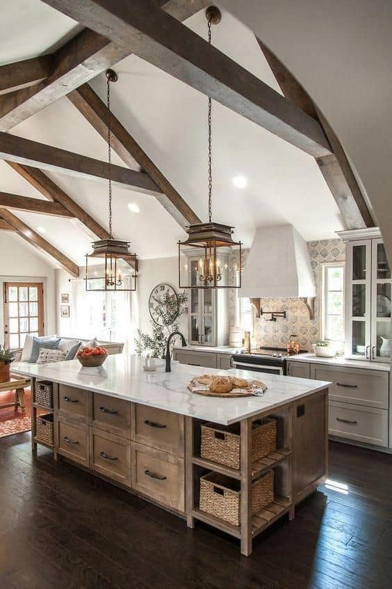 Tips for styling a farmhouse kitchen; rustic island, wood beams