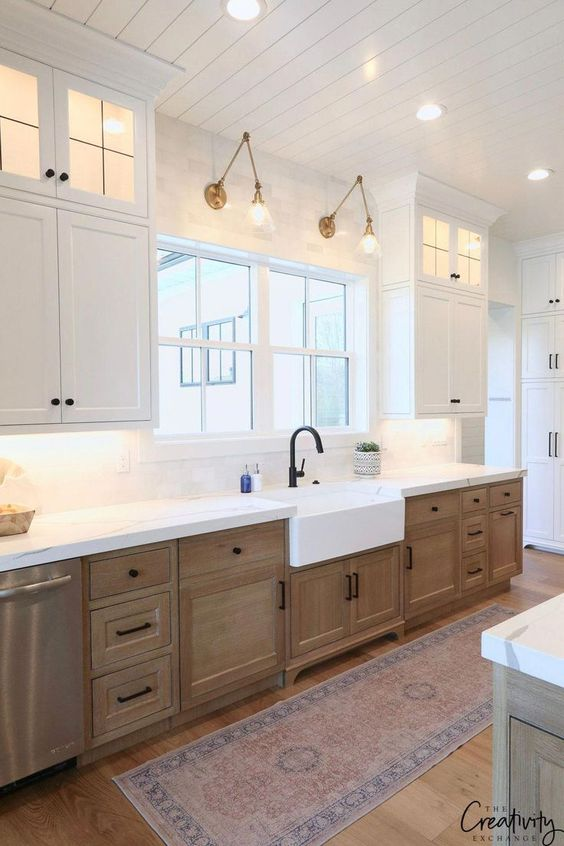 Tips for styling a farmhouse kitchen; lower wood cabinets, rustic cabinets, white farmhouse kitchen, white farmhouse sink, over window lights