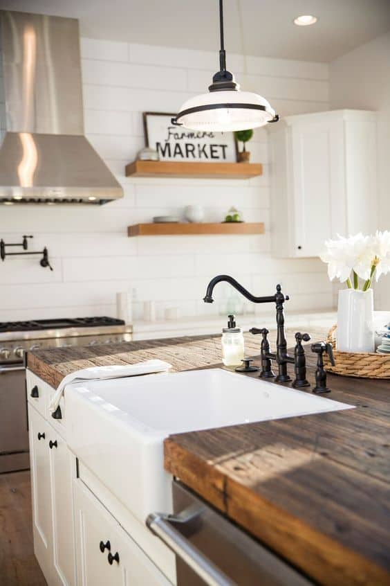 Tips for styling a farmhouse kitchen; wood countertops, rustic counters, kitchen wood counters, white farmhouse sink, open kitchen shelving
