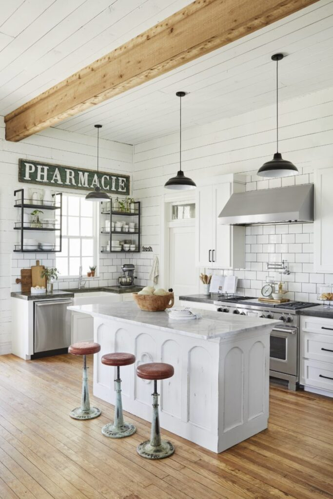 White farmhouse kitchen, shiplap kitchen, antique signs; Joanna Gaines Full Farmhouse Tour: Entire look inside Chip and Joanna Gaines's home