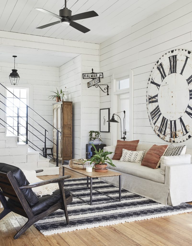 White shiplap walls, large antique clock, white couch: Joanna Gaines Full Farmhouse Tour: Entire look inside Chip and Joanna Gaines's home