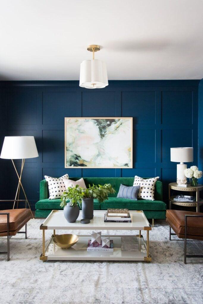 Studio Mcgee living room, Dark blue walls, Navy living room, green couch