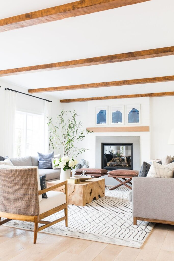 Studio Mcgee living room, wood beams, white fireplace