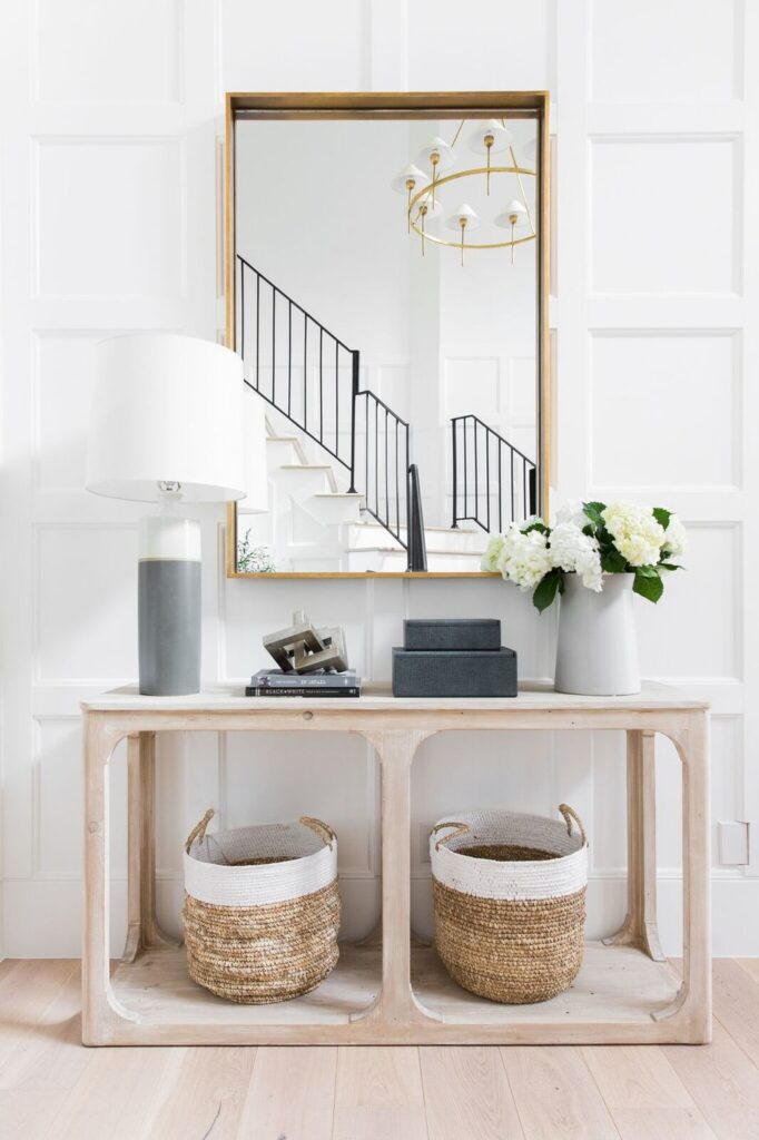 Studio Mcgee living room, accent table, large mirror, woven baskets